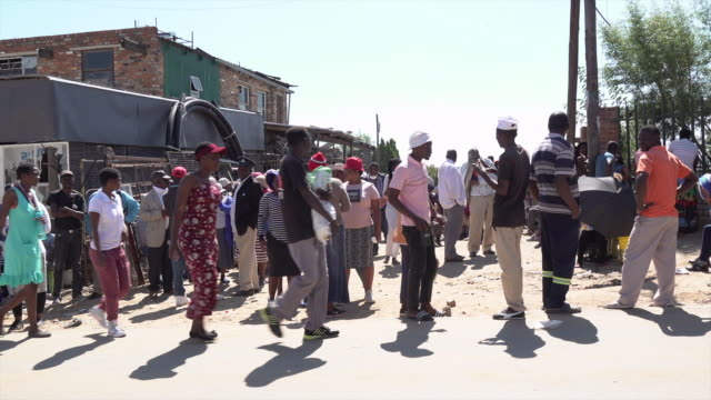 looting and protests have broken out in south africa - where one of the strictest lockdown regimes in the world continues. shows: people in queues... - south africa stock videos & royalty-free footage