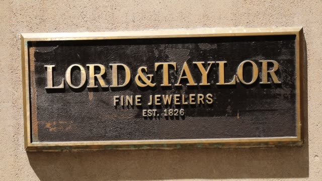 a lord and taylor sign is displayed on its flagship store on 5th avenue in manhattan on june 6 new york city the 192 year old chain owned by canada's... - flagship store stock videos and b-roll footage