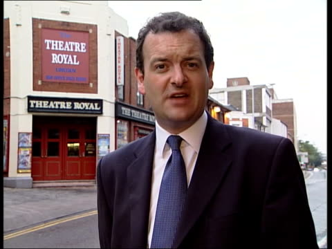 lord archer dayrelease community project work in theatre lincoln i/c gv theatre royal tilt down vox pops locals archer driving bmw car towards pan - theatre royal stock videos and b-roll footage