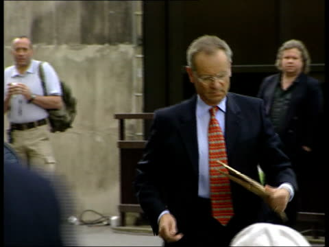day 2 itn england london lord archer arriving at the old bailey for perjury trial pan as shakes hands with supporter on way in ted francis... - defendant stock videos & royalty-free footage
