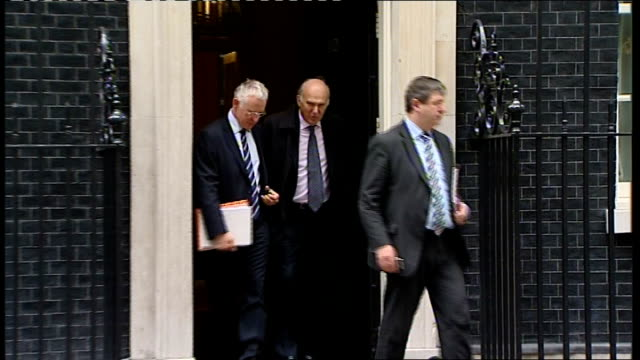 lord browne report on university funding published; london: downing street: vince cable mp and two others departing number 10 lib / 3.5.2010... - vince cable stock videos & royalty-free footage