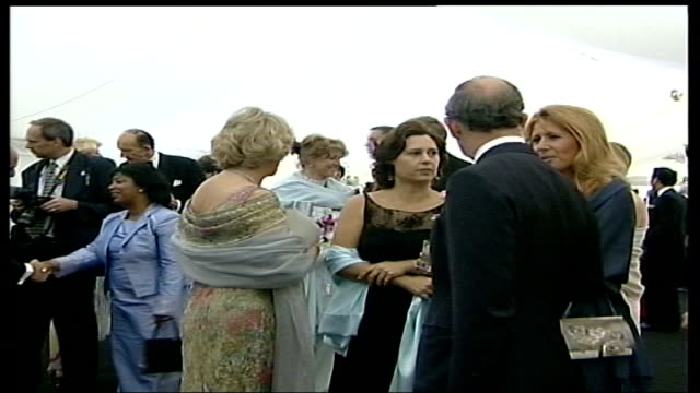 lord carey says prince charles should marry camilla lib prince charles and camilla parker bowles in floral dress and grey shawl at drinks party - shawl stock videos and b-roll footage