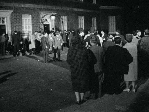 lord home asked to form government; 9.pm b/g title: england: no10, downing st.: ext / night: man from number 10 and into car lord home leaves no10.... - alec douglas home video stock e b–roll