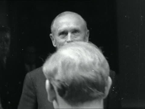 lord home asked to form government; i) england: london: downing street: no10: ext lord home arrives no10. amid pressmen: waves from steps: - alec douglas home video stock e b–roll