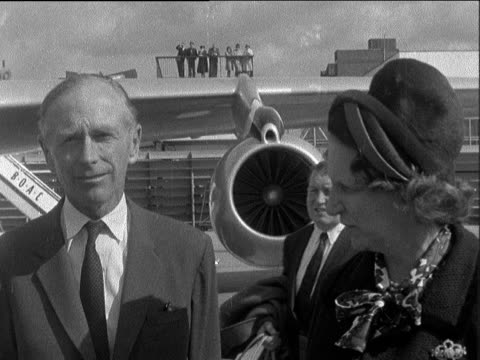 lord home interview; england: london: lap : ext lord home and wife baroness home and up steps to plane - alec douglas home video stock e b–roll