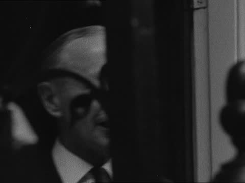 lord home is new premier; b) england, london, buckingham palace: ext gv palace and crowd outside lord home's car in to bv guard at palace lord home's... - alec douglas home video stock e b–roll