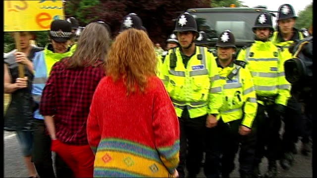 Lord Howell suggests fracking move to 'desolate' North East ENGLAND West Sussex Balcombe EXT Police officers escorting lorry towards Antifracking...
