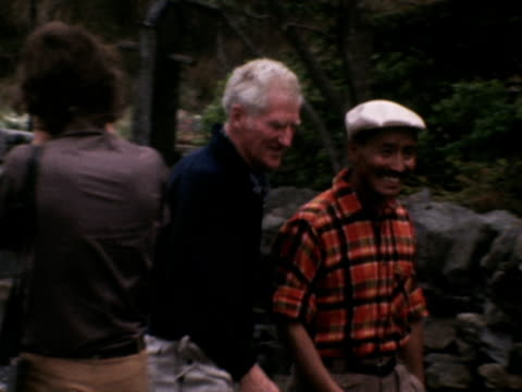 vidéos et rushes de lord hunt and tenzing norgay walk along a path during a 20th anniversary reunion of the 1953 mount everest expedition squad - 1953