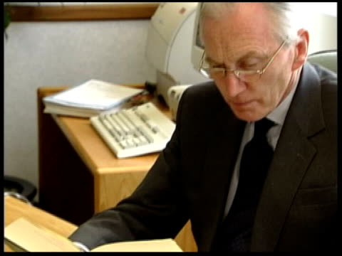 intelligence lib lord hutton sitting reading at desk set ups - weapons of mass destruction stock videos & royalty-free footage