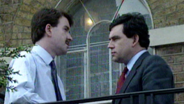 lord mandelson's memoirs criticised by labour mps tx 1551990 london ext mandelson talking to gordon brown on balcony - ピーター マンデルソン点の映像素材/bロール