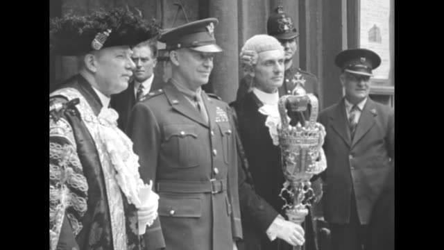 Lord Mayor of London US Gen Dwight Eisenhower and Prime Minister Winston Churchill stand on balcony of Mansion House after Eisenhower's remarks to...
