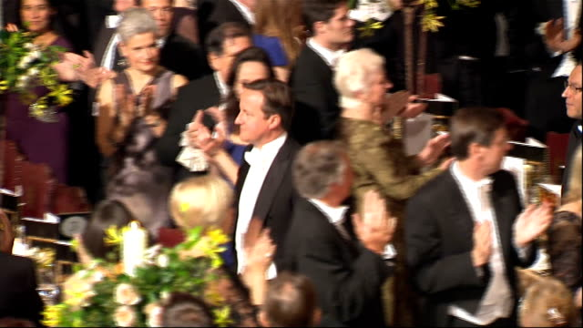 lord mayor's banquet arrivals high angle shot banquet hall as trumpet fanfare played sot / music plays and crowd clap as cameron woolf archbishop of... - ジャスティン・ウェルビー点の映像素材/bロール