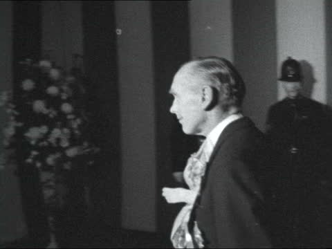 sir alec douglas-home speech; 8.55 pm england: london: guildhall: lord mayor's banquet: int lord mayor, alderman clement harman, and his wife arrival... - alec douglas home video stock e b–roll
