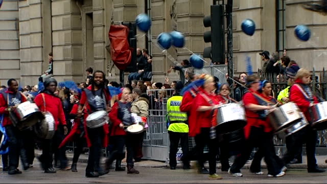 lord mayor's show takes place in london england london city of london ext people in costumes and masks and bands along street as part of the lord... - lord mayor of london city of london stock videos & royalty-free footage