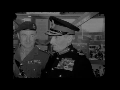 lord montgomery opens new para regt museum; england: aldershot: ext gvs troops and field marshal bernard montgomery inspecting int gvs monty looking... - aldershot stock videos & royalty-free footage