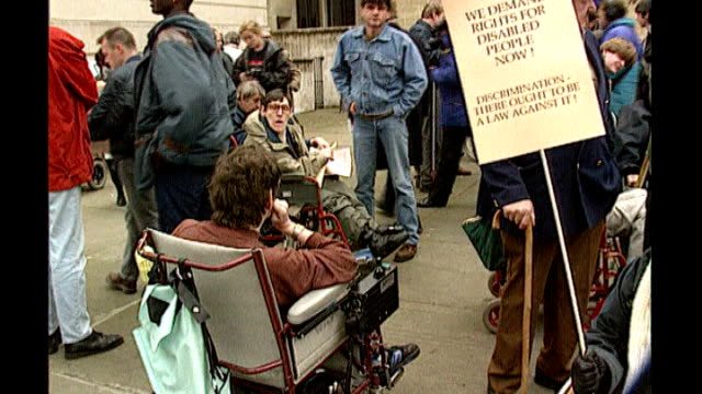 Lord Morris dies aged 84 LIB EXT Various shots of Alf Morris with disabled people protesting outside Dept of Social Security