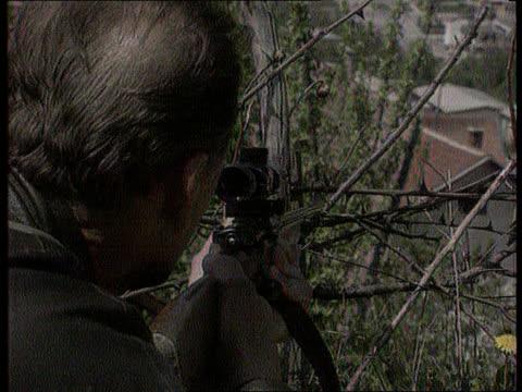 lord owen; bosnia herzegovina: sarajevo: lms militiamen running across street cbv sniper looking through rifle tms militia men in alley way l-r - bosnia and hercegovina stock videos & royalty-free footage