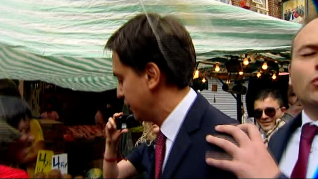 lord prescott criticises 'failing' labour lib / tx london walworth ext ed miliband mp being hit by egg during visit to market - ed miliband stock-videos und b-roll-filmmaterial