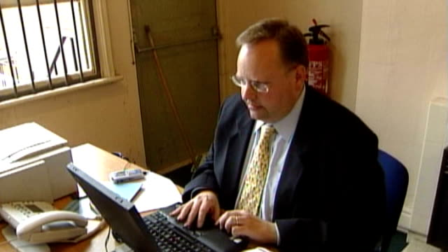 lord rennard may be 'kicked out' of lib dem party t24060466 / tx lord rennard working on laptop computer at desk london westminster ext union jack... - クリス・レナード点の映像素材/bロール