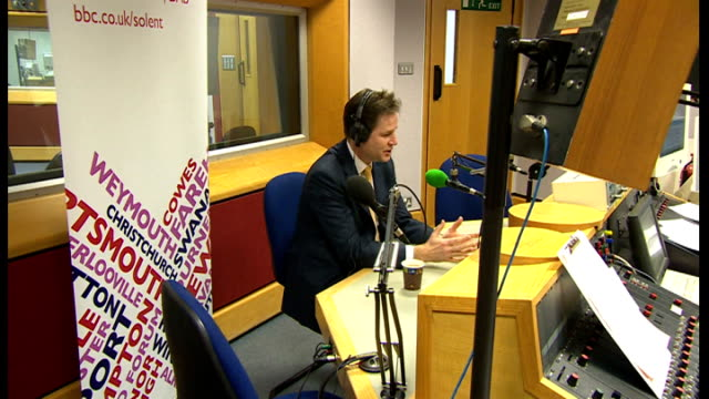 nick clegg at radio solent newspapers on radio presenters desk nick clegg mp in bbc radio solent studio sat at desk interview sot we've had braodacst... - クリス・レナード点の映像素材/bロール