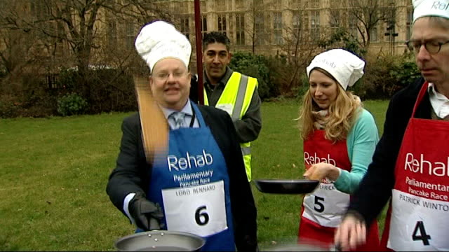 nick clegg denies coverup r12021311 / 1222013 england london westminster college green ext various of lord rennard flipping pancakes along with other... - chef's hat stock videos and b-roll footage