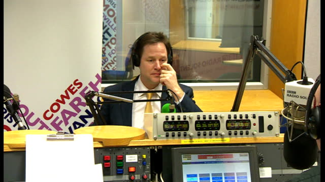 police looking at formal complaints various cutaways of nick clegg mp seated in radio studio during bbc radio solent interview - クリス・レナード点の映像素材/bロール