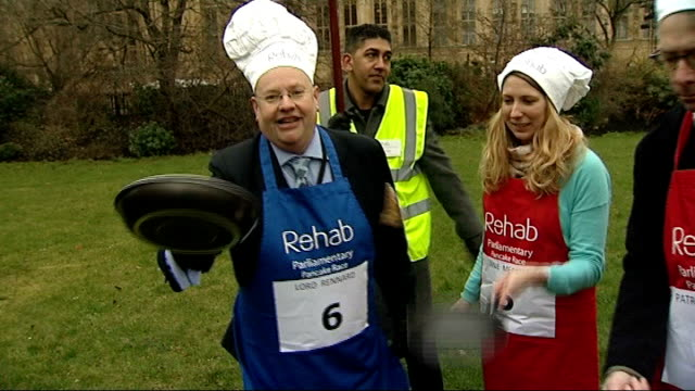 police looking at formal complaints r12021311 / 1222013 london westminster college green ext various of lord rennard flipping pancakes along with... - chef's hat stock videos and b-roll footage