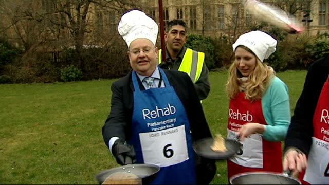 police looking at formal complaints r12021311 / 1222013 england london westminster college green ext various of lord rennard flipping pancakes along... - chef's hat stock videos and b-roll footage