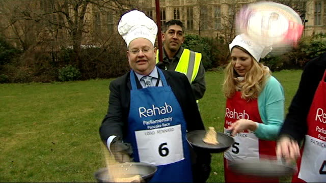 police looking at formal complaints r12021311 / 1222013 london westminster college green ext various of lord rennard flipping pancakes along with... - クリス・レナード点の映像素材/bロール