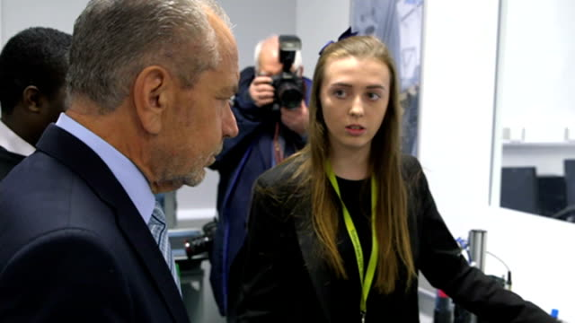 lord sugar visits tottenham university technical college england london tottenham tottenham utc int various of lord sugar watching robot arm being... - technical college stock videos & royalty-free footage
