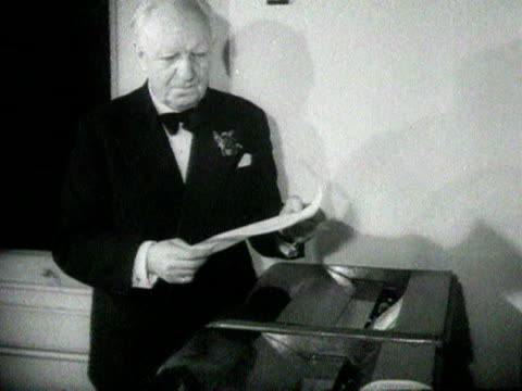 lord woolton the chairman of the conservative party looks at election results and smiles at the camera during the 1951 general election. 25 october... - ordförande bildbanksvideor och videomaterial från bakom kulisserna