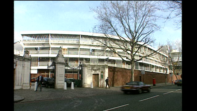 london st john's wood ext entrance to lords cricket ground with stand seen beyond walls / inscription on pillar next to the grace gates / traffic... - lords cricket ground stock videos and b-roll footage