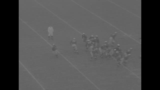 loren mckinney harvard crimson runs ball tackled for first down in game against yale bulldogs at yale bowl / donald mcnichol harvard throws pass to... - joe pass stock videos and b-roll footage