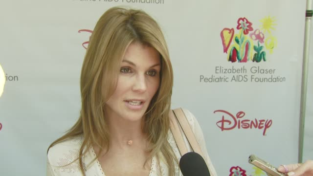 lori loughlin on the event the booth she's working working on beverly hills 90210 what she's looking forward to about today at the a time for heroes... - lori loughlin stock videos & royalty-free footage