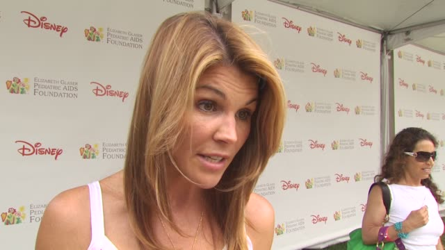 lori loughlin on why she attends every year and her favorite thing about being at the event at the 21st annual 'a time for heroes' celebrity picnic... - a time for heroes stock videos & royalty-free footage