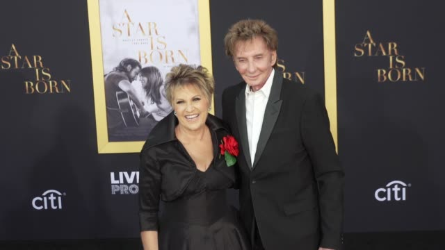 """lorna luft and barry manilow at the """"a star is born"""" los angeles premiere at the shrine auditorium on september 24, 2018 in los angeles, california. - バリー・マニロウ点の映像素材/bロール"""