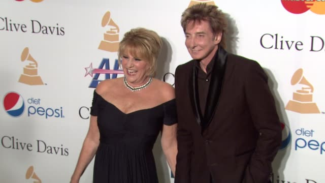 lorna luft, barry manilow at the pre-grammy gala & salute to industry icons with clive davis honoring david geffen at beverly hills ca. - バリー・マニロウ点の映像素材/bロール