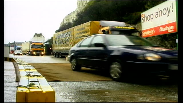 Lorries along through Foot Mouth disinfectant ENGLAND Dover EXT Lorries driving through Foot Mouth disinfection point at Dover docks / tyres of...