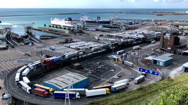 lorries and passengers arrive and depart from dover ferry terminal on april 26, 2018 in dover, england. after speeking to a parliamentary committee... - docks stock videos & royalty-free footage