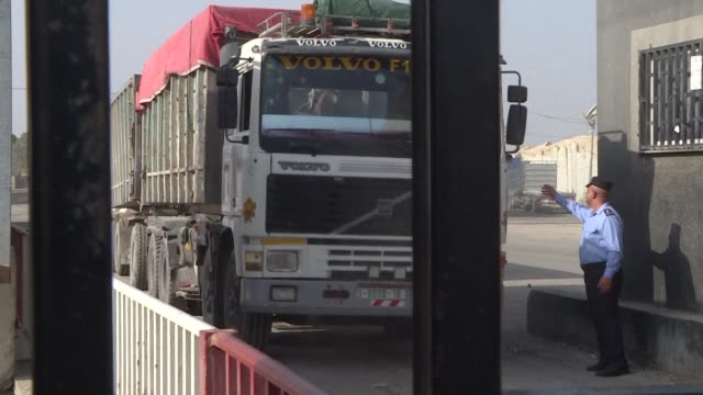 Lorries cross the Kerem Shalom crossing in the southern Gaza Strip after Israel opened the country's goods and people border crossings with Gaza just...