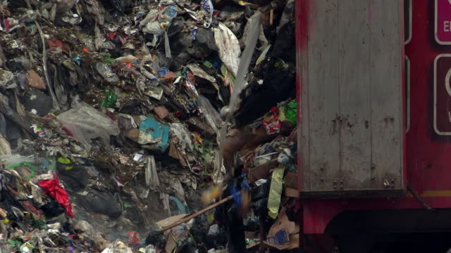 lorries offload waste at a recycling centre - bin bag stock videos & royalty-free footage