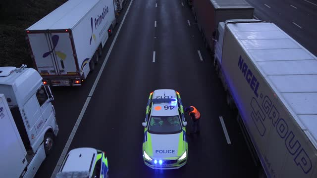 lorries parked on the m20 in kent after the port of dover was closed after the french government's announcement it will not accept any passengers... - kent england stock videos & royalty-free footage