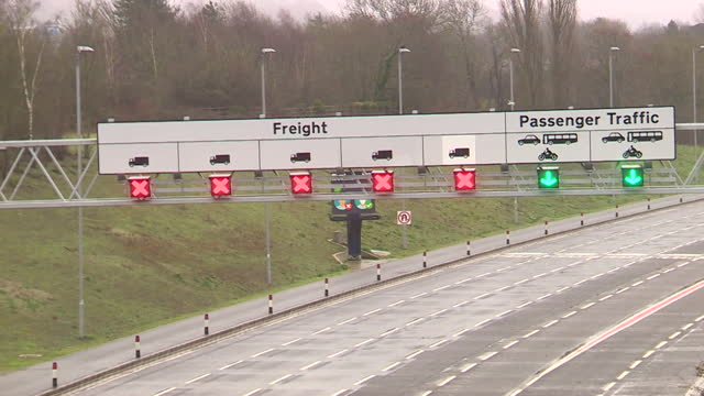 lorries queueing on m20 in dover as the port is closed to freight transportation after france closes its borders to uk after new coronavirus variant - medical research stock videos & royalty-free footage