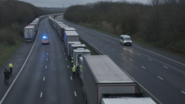 lorries stranded on m20 in kent towards dover/channel tunnel due to closed borders and brexit - kent england stock videos & royalty-free footage