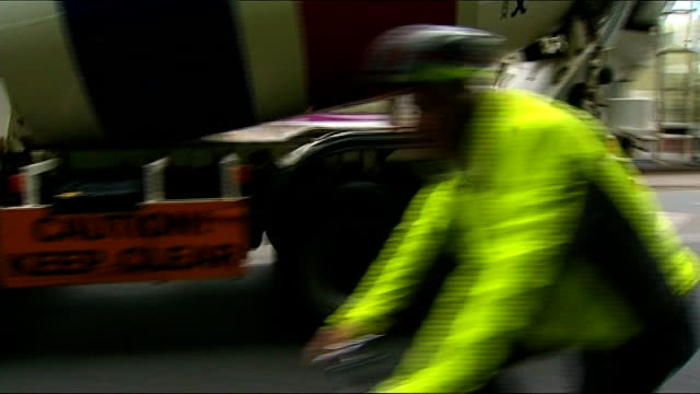 lorries to have new safety equipment fitted to protect cyclists t25071149 / tx ext jon snow cycling along road next to lorry snow on bike seen... - overtaking stock videos and b-roll footage