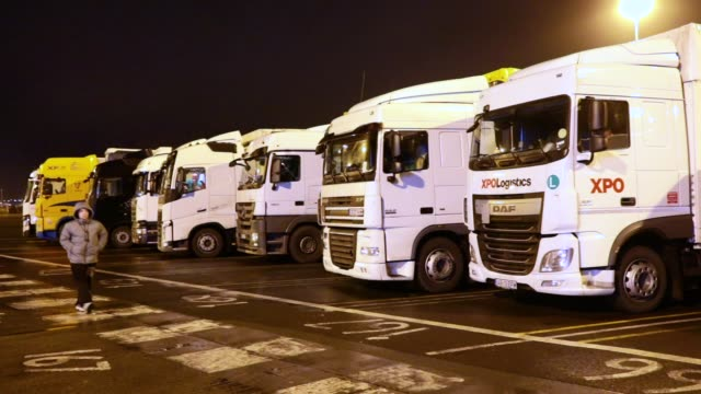 Lorries wait to board a ferry at the port of Dover in the early hours on March 5 2018 in Dover England The haulage industry faces an uncertain future...
