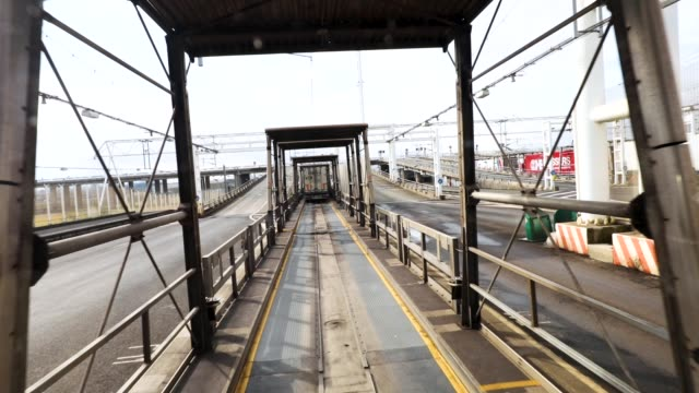 lorries wait to board a freight train in calais on march 6 2018 in calais france the haulage industry faces an uncertain future while brexit... - haulage stock videos & royalty-free footage