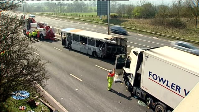 lorry and coach collide on m5 motorway: coach driver arrested; england: near birmingham: m5 motorway: ext 'fog patches - slow down' sign over... - itv weekend late news点の映像素材/bロール