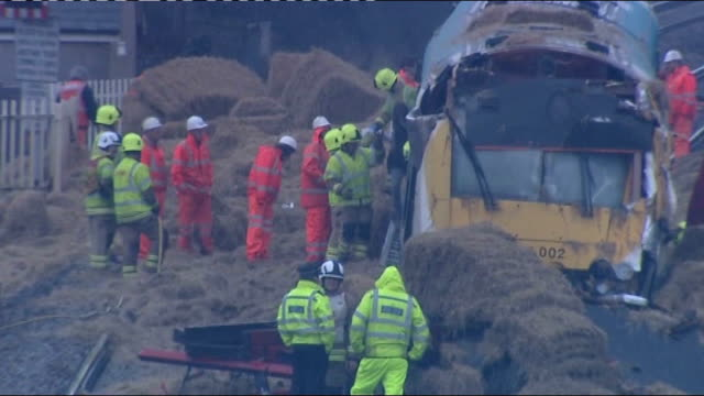 lorry driver arrested following collision with train; wales: carmarthenshire: whitland: ext various shots of emergency service workers at scene of... - cricket stump stock videos & royalty-free footage