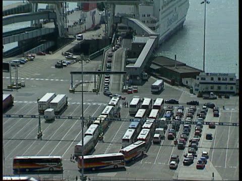 dover ext air view cars and lorries queuing for ferry at port - itv weekend evening news stock-videos und b-roll-filmmaterial